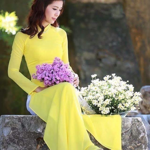vải áo dài trơn màu vàng
